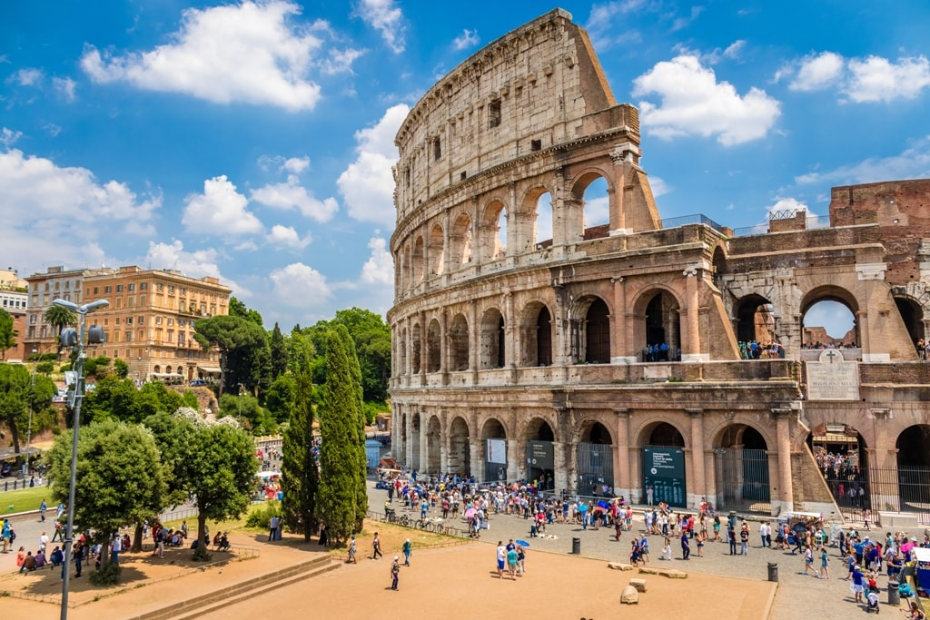 Colosseum-with-clear-blue-sky-Rome-Italy_-Rome-landmark-and-antique-architecture_-Rome-Colosseum-is-one-of-the-best-known-monuments-of-Rome-and-Italy-min.jpg